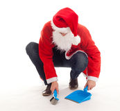 Sweeping Christmas man with dustpan Stock Images