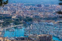 Sweeping cityscape of Palma Mallorca. Sweeping panorama overlooking Palma Mallorca with the marina in the foreground and the city in the background Royalty Free Stock Photo