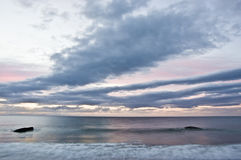 Sweeping clouds and sea at sunrise with WW2 defence bunkers Stock Images