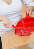 Sweeping  with dustpan Stock Images
