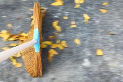 Sweeping the floor. With moving motion over ground and leaves Royalty Free Stock Images
