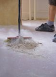 Sweeping the floor with a broom Royalty Free Stock Image