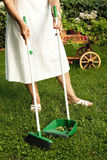 Sweeping the garden Stock Images