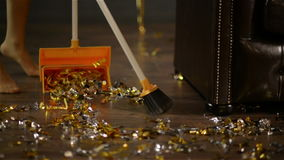 Sweeping of Golden and Silver Confetti at the End of the Party. Colorful Paper on the Floor. Closeup of Female Legs and. A Broom. Housekeeping Concept, HD stock footage