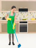 Sweeping the kitchen floor Stock Photo