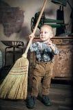 Sweeping little boy Stock Photos