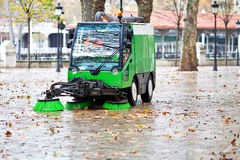 Sweeping machine. Picking the leaves of the trees Royalty Free Stock Photography