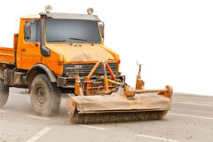 Sweeping machine. Cleans the street Royalty Free Stock Photography