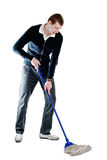Sweeping man. Tall man sweeping a room. Isolated on white Royalty Free Stock Photos