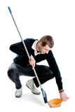 Sweeping man. Tall man sweeping a room. Isolated on white Stock Photography