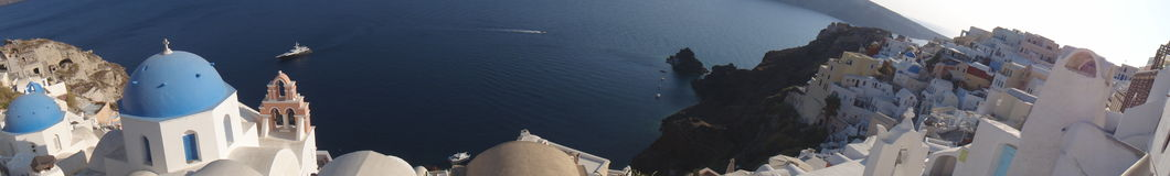 Sweeping Panorama from the cliffs of Oia, Santorini Royalty Free Stock Image