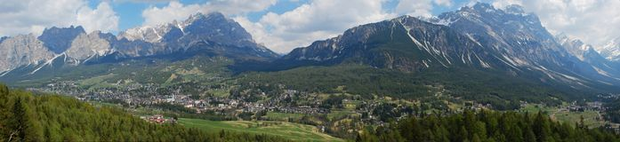 Italian Dolimite Peaks and the famous Cortina dAmp. Sweeping wide panorama of Cortina dAmpezzo and the Italian Dolomite mountains with its world-famous ski Royalty Free Stock Photo