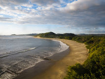 Sweeping panorama of waves rolling onto Nicaragua coast Stock Images