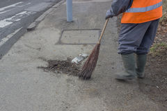 Sweeping and pushing a broom Royalty Free Stock Photography