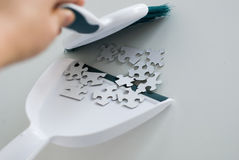 Sweeping the puzzle Stock Photos