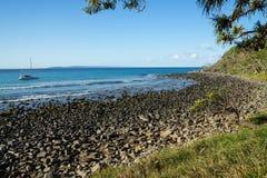 Sweeping rocky beach coastline stock image