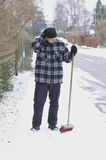 Sweeping snow. Man sweep new snow off sidewalk in winter Stock Photography