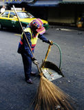 Sweeping the streets. Bangkok street cleaning Stock Photography