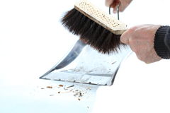 Sweeping up. Hands holding broom and dust pan sweeping up Royalty Free Stock Photos