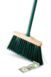 Sweeping up cash. Broom and banknote on a white background royalty free stock photography