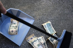Sweeping up money Royalty Free Stock Images