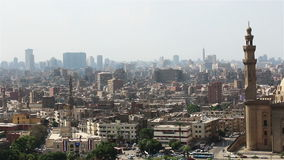 Sweeping views across Cairo from the Citadel. Mosque of Sultan Hassan. stock footage