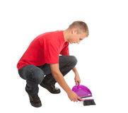 Sweeping young man Stock Photo