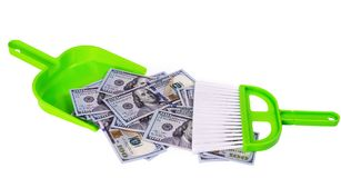 Sweeps money in the shovel on the white background. Sweeps cash money banknote in the shovel on the white background, sweeping brush shove concept garbage Stock Image