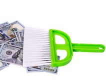 Money sweeping brush concept garbage. Sweeps cash money banknote on the white background, sweeping brush concept garbage Royalty Free Stock Photo