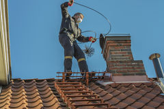 Sweeps the chimney Stock Photo