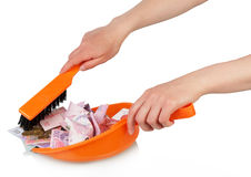 Sweeps money in the scoop Royalty Free Stock Image