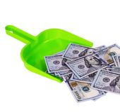 Sweeps money in the shovel concept garbage. Sweeps cash money banknote in the shovel on the white background, concept garbage Royalty Free Stock Image