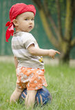 Sweer baby girl with a football. In the garden Royalty Free Stock Photos