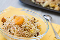 Sweet African Couscous. Seffa de Couscous, a traditional sweet dish from Algeria and Morocco made with cinnamon and dried fruits like raisins and apricots Stock Photo