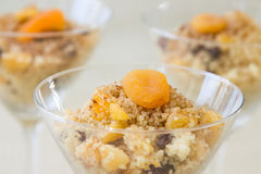 Sweet African Couscous. Seffa de Couscous, a traditional sweet dish from Algeria and Morocco made with cinnamon and dried fruits like raisins and apricots Stock Photos