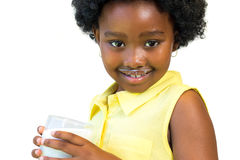 Sweet african girl drinking milk. Royalty Free Stock Photography