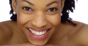 Sweet African woman smiling at camera stock photo