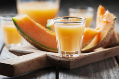 Sweet alcoholic liqueur with melon. Selective focus Royalty Free Stock Photo