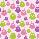 Sweet aliens vector seamless pattern. Cute cartoon creatures texture in colors of pink, purple and green. Sweet aliens vector seamless pattern. Hand drawn funny Royalty Free Stock Image