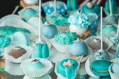 Sweet almond colorful tiffany colored blue macaron or macaroon dessert cake. French sweet cookie. Minimal food bakery concept.  royalty free stock images