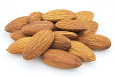 Sweet almonds. Sweet dried almonds on a white background royalty free stock photography