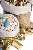 Sweet almonds and chocolate bunnies Royalty Free Stock Image