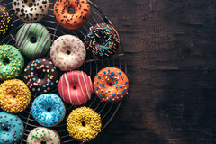 Sweet American donuts. On wooden background on wooden background with blank space stock photos