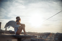 Sweet angel girl. Fallen on the roof, art photo Stock Image