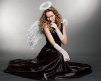 Sweet angel sitting on the floor Royalty Free Stock Photography