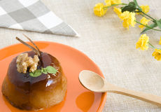 Sweet apple dessert. A gourmet apple dessert with nut and cinnamon. Copy space Stock Photo