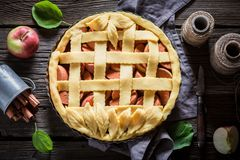 Sweet apple pie with cinnamon and fresh fruits Royalty Free Stock Images