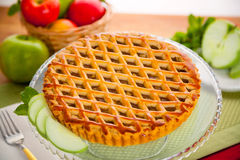 Sweet apple pie tart served on table fresh ingredients organic perfect lattice Royalty Free Stock Images