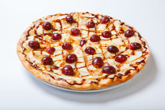 Sweet apple pizza with sliced grape on white background Stock Photography