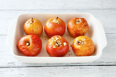 Sweet apples baked in a baking dish Royalty Free Stock Image